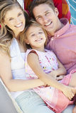 Family Relaxing In Garden Hammock Together Royalty Free Stock Images