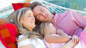 Family Relaxing In Garden Hammock Together stock video