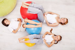 Family relaxing after gymnastic exercise Royalty Free Stock Photos