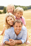 Family Relaxing In Summer Harvested Field Royalty Free Stock Image