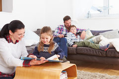 Family Relaxing Indoors Together Stock Photography
