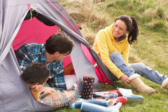 Family Relaxing Inside Tent On Camping Holiday Royalty Free Stock Photos