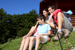 Family relaxing by the mountain cabin Royalty Free Stock Photos