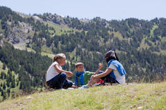 Family relaxing in the mountain Royalty Free Stock Photography