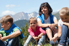 Family relaxing in the mountain Stock Photos