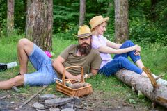 Family relaxing near bonfire after day of mushroom hunting. Family traditions. Couple relaxing after gathering mushrooms. In wild for food. Family activity for royalty free stock photography
