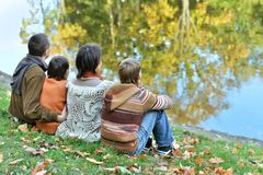 Family relaxing near lake Stock Photography