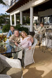 Family relaxing on outdoor patio Royalty Free Stock Image