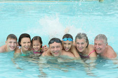 Family relaxing in  pool Royalty Free Stock Image