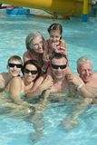Family relaxing in the pool Royalty Free Stock Photos