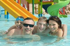 Family relaxing in the pool Royalty Free Stock Image