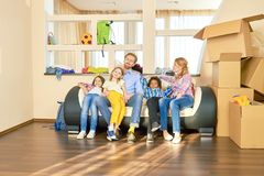 Family relaxing after relocation. Royalty Free Stock Photos