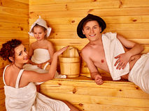 Family relaxing in the sauna. Happy family in hat  relaxing at sauna Stock Photos