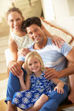 Family Relaxing On Sofa At Home Royalty Free Stock Images