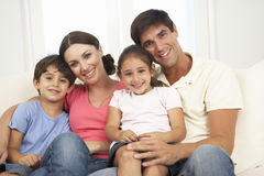 Family Relaxing On Sofa At Home Together Stock Photography