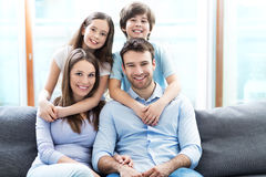 Family relaxing on sofa Royalty Free Stock Photos
