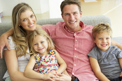Family Relaxing On Sofa Together Royalty Free Stock Images