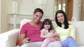 Family relaxing on sofa together  stock footage