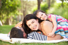 Family Relaxing In Summer Garden Stock Photography