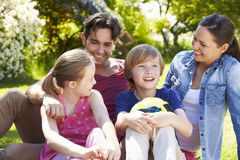 Family Relaxing In Summer Garden Royalty Free Stock Photos