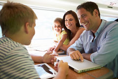 Family Relaxing On Train Journey Royalty Free Stock Photo