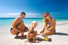 Family relaxing on tropical beach Stock Image