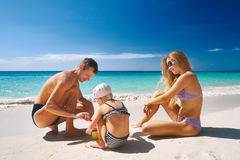 Family relaxing on tropical beach Royalty Free Stock Photo
