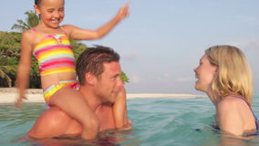 Family Relaxing In Tropical Sea stock video footage