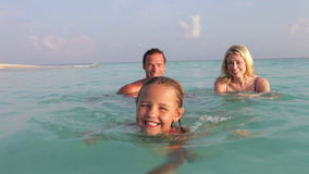 Family Relaxing In Tropical Sea stock video