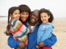Family Relaxing On Winter Beach Break Royalty Free Stock Photography