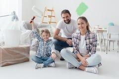 Family renovating their new apartment royalty free stock photo