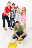 Family repainting their home together royalty free stock images