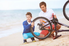 Family repairing bike Stock Photo