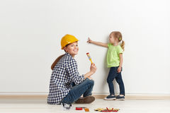 Family reparing house Royalty Free Stock Images