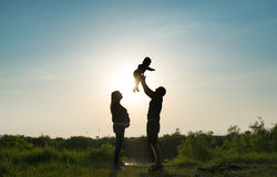 Family rest on a sunset. Royalty Free Stock Image