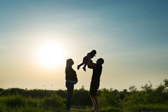 Family rest on a sunset. Royalty Free Stock Images