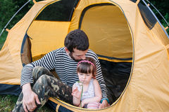 Family rest in tent, dad and daughter tourists Stock Images