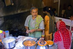 Family restaurant. A man is cooking Alu-da-Paranda, a famous north Indian potato-bread for tourists in Manali, Himachal Pradesh, India Stock Photography