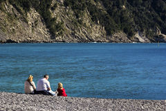 Family resting on the beach in Camogli, Italy Stock Photo