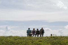 Family resting on dike Royalty Free Stock Photo