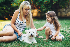 Family resting with dog Royalty Free Stock Photography