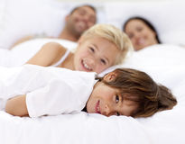 Free Family Resting In Parent S Bed Stock Photos - 11541713