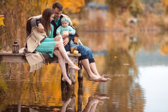 Family resting on the lake Royalty Free Stock Images