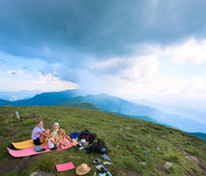 Family resting on a mountain top Stock Images