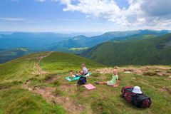 Family resting in a mountain walk Royalty Free Stock Photo