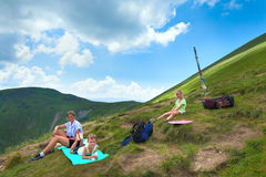 Family resting in a mountain walk Royalty Free Stock Photography