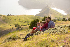 Family resting in mountains Royalty Free Stock Photos