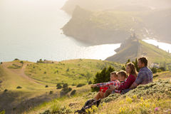 Family resting in mountains Stock Image