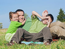 Family resting outside Stock Photography