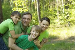 Family resting in summer park Royalty Free Stock Photos